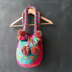 "Fairtrade Pompones Wayuu Mochila Bag. I hope this ""fairtrade"" word used in the website is truly fair."