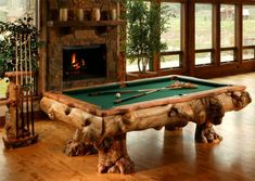these amazing pool tables are made using logs from Colorado and Wyoming. A very unique table handcrafted in the Roaring Fork Valley near Aspen, this billiard table is sure to capture attention in any rustic retreat.
