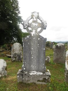 Headstone - Celtic cross / a sheep in the center and Celtic knots. Circles are often around Celtic knots to represent a spiritual unity that cannot be broken.