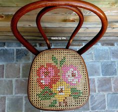 How cool is that?! Cross-stitch a caned chair with yarn - totally removable if it gets worn or you just want to change the design . . . hmmm