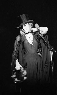 Stevie onstage   ~  ☆♥❤♥☆  ~     smiling slightly and rubbing the back of her neck as if she has a crick in it