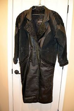 Wilsons Black Leather Trench Coat Ladies Size Medium Suede Embellishments Pre-owned   This long leather coat has beautiful suede shoulders and back with impri