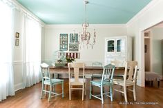 mis-matched chairs, aqua ceiling