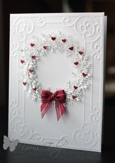 hand made card. Change up the decorations for a Christmas wreath. Love it used with that embossing folder.