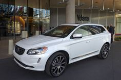 A three-quarter front view of a white 2015 Volvo XC60