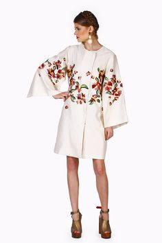 An edgy and striking Jacket with long kimono sleeves and a round neckline.