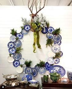 We made a wreath wall with some blue and white plates & topped it off with a big grapevine deer head & a ginormous bow.😂 I see some places… Blue Christmas Decor, Cool Christmas Trees, White Christmas, Christmas Decorations, Holiday Decor, Preppy Christmas, Christmas Mantles, Cottage Christmas, Christmas Villages