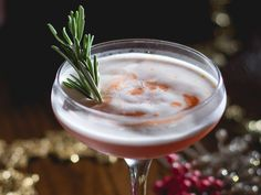 Spiced Cranberry Sour  2 ounces bourbon  1/2 ounce lemon juice  1/2 ounce cranberry juice  1/2 ounce Tippleman's Double Spiced Falernum  1 egg white  Cranberry bitters  Angostura Bitters  Orange, for zest  Rosemary sprig