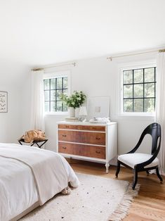 A relaxing bedroom with neutral hues. Small Room Bedroom, White Bedroom, Bedroom Ideas, Dresser As Nightstand, White Paints, Home Renovation, Bed Frame, House Design, Interior Design