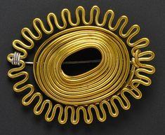Brass pin designed and made by Alexander Calder, 1939, estimate $20,000-$30,000, at Skinner, Boston, September 10, 2013