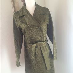 """Dragon Rare Michelle Decourcy Brocade Trench Small Rare Michelle DeCourcy Green Brocade Trench Coat Size Small. Cool dragon design. Purchased in Northwest Portland, Oregon, 2004. Worn only a few times, stored in garment bag - not my size anymore. Measurements: shoulder 14.5"""" across back, Sleeve 24"""" shoulder seam to cuff, Length armpit to hem 27"""". Fully lined, belted, double breasted. Very good condition from my non smoking home. I am creating another listing to show lining, collar, cuff…"""