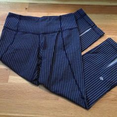 NWOT Lululemon striped crop Lulu Gather and Crow crop in navy blue and white pinstripes. Super cute crop with slits on the back calf area lululemon athletica Pants Leggings