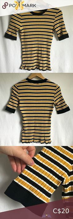 """Zara Black, White and yellow stripe t-shirt size M Zara Black, White and yellow stripe t-shirt size M This striped knit top is super cute and trendy. The fabric is a soft, super stretchy ribbed knit that hugs the body. This shirt has a bold black collar and sleeve cuffs. It would look great  with mom jeans or high waisted shorts.  Size: M Brand: Zara Basic  Material:    Measurements lying flat Chest: 12"""" Waist: 11"""" Length: 22"""" Sleeve length: 10"""" Zara Tops Tees - Long Sleeve<br> Grey Long Sleeve Tops, Long Sleeve Tees, Zara Black, Black White, Formal Tops, Zara Shirt, Denim Top, Knit Shirt, Yellow Stripes"""