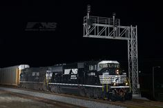 """Norfolk Southern train 298 rolls east through Tallapoosa, Ga., during the last few minutes of 9/11/14. Leading its first train after upgrades at our Juniata Shop is """"triclops"""" SD60M #6814. Built in 1989 as Burlington Northern 9207, 6814 is one of 8 ex-BN units recently acquired from National Railway Equipment, and the first to receive the Thoroughbred paint scheme. www.nscorp.com"""