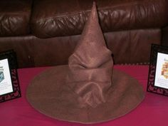 Harry Potter Sorting hat!! handmade using Brown felt from Micheal's (0.29 a sheet, used 7 sheets) and an old witch's hat.... cost less than 3 bucks to make...