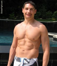 a musclestud lounging poolside gay party photos