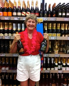 Sarasota Sister City Event Director Gayle Maxey holds two selections of Treviso Province Prosecco from the Conegliano region in Italy at the newly opened Trader Joe's in Sarasota on September 7, 2012. The Conegliano Poggio delle Robinie extra dry prosecco and the brut Millesimato Conegliano Valdobbiadena prosecco superior are in the sparkling wine area. Treviso Province, Italy was twinned with Sarasota in 2007
