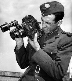 "Damien Parer (1912-1944) Australian war photographerand cameraman. As official movie photographer to the Australian Imperial Force (AIF) during WWII, he covered Libya, Greece, Syria and the Kokoda Track in Papua New Guinea. His most famous image was an Australian soldier supporting his wounded mate. He was cinematographer for Australia's first Oscar-winning film, ""Kokoda Front Line!"", and died from Japanese machine gun fire on Palau (1942) © smh www.imdb.com/title/tt0034951/"