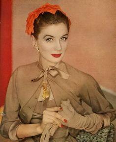 Love the contrasting orange hat ! 1950s fashion.