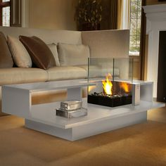 Level is a tabletop and fireplace that turns any sitting area into a cozy gathering of friends. The glass is thick and tempered, so it's safe whether you want to add fuel and create a fire or use it as a protective shield for your favorite candle.