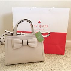 NWT Authentic Kate Spade Dominique Bow Bag 🎉 HOST PICK 🎉  NWT Authentic Kate Spade Murray Street Dominique Bow Bag in the color Pebble. I bought this a few months ago thinking I was gonna use it but never did. It is in perfect condition with no signs of damage or stains. Additional pictures will be uploaded upon request. Price is a little negotiable so feel free to make me an offer through the offer button. Reasonable offers will be accepted. 😄 kate spade Bags Satchels