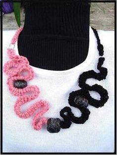 Make a Curly Crochet Necklace to accessorize your outfit with. This is an easy crochet pattern you can work up in a short time. Use two of your favorite colors or simply keep it a solid.