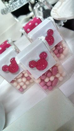 Decorated tic tac containers at a Minnie Mouse Birthday Party!  See more party ideas at CatchMyParty.com!