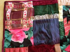 This quilt is called the Mamas Roses fidget quilt. It is approximately 19 x 20. The fidget quilt is backed with minkee-like fabric. This quilt has at least ten textures and five fidget items. Fidget items: -Marble maze (Marble is under fabric. If stitching comes loose, the marbles could come out.) -Weaving ribbon -Tugging Ribbon -I Spy (Various items under chiffon. Items could come out if this area is chewed on.) -Belt buckle  When I first heard about fidget quilts, I was so excited to have…