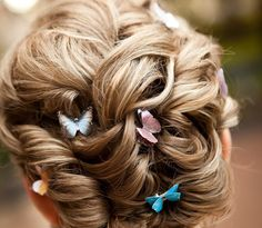 Something like this but with some loose curls on the sides and white flowers instead of butterflies