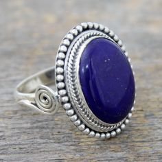 NOVICA Sterling Silver Cocktail Ring with Lapis Lazuli from India ($48) ❤ liked on Polyvore featuring jewelry, rings, blue, single stone, statement rings, handcrafted sterling silver rings, sterling silver statement ring, handcrafted rings and blue sterling silver rings