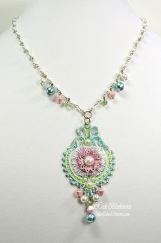 Colored filigree necklace made with Gesso and Mixed media pens