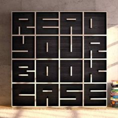 Modular bookcase of letters and numbers lets you turn your shelves into a message
