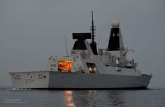 Royal Navy Tye 45 destroyer HMS Diamond is pictured at dusk in the Middle East.