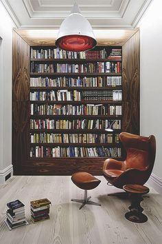 Reading Spot | block | bookcase | shelves | black | laquered | wood | reading | leather chair with stool | lighting | cosy | study |