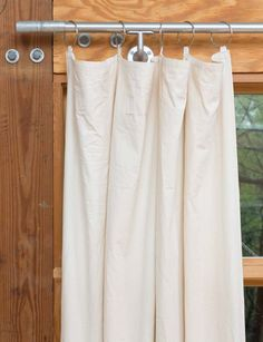 Make curtains from a canvas dropcloth  http://blog.diynetwork.com/maderemade/how-to/how-to-make-curtains-for-industrial-window-treatments?soc=pinterest