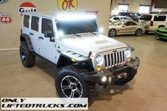 http://www.onlyliftedtrucks.com/4364-2012-lifted-jeep-wrangler-4wd-unlimited-rubicon-mw3/details.html