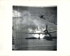 "1944- Fire fighters save plane and pilot after F6F ""Hellcat"" burst into flames aboard the carrier U.S.S. COWPENS."