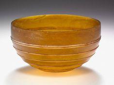 Amber Bowl with White Ridges. Unknown, Roman, A.D. 1–100. Glass, 4 1/16 in. diam. 2003.475. The J. Paul Getty Trust © J. Paul Getty Trust.