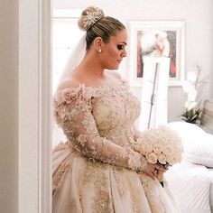 Here is a long sleeve plus size wedding gown that has beautiful flower embellishments. This off the shoudler style can be recreated with any changes. We are in the USA and make custom #weddingdresses. We also make #replicas of couture designer gowns for brides who can not afford the original. Email us directly for pricing. DariusCordell.com