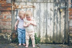 Little twins Sophie and Gemma wearing Fable Baby organic cotton Frill Singlets (AUD$39), Spot Pants (AUD$49) and Coral Animal Leggings (AUD$49)