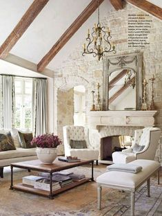 Shabby-Chic living room with cathedral beam ceiling arched doorway stone brick wall stone fireplace and carpet flooring. - April 14 2019 at Daybed In Living Room, Coastal Living Rooms, Shabby Chic Living Room, Living Room Decor, Dining Room, Stone Wall Living Room, Cozy Living, Living Area, Cottage Living