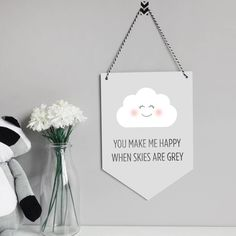 An adorable hanging wall flag for your childs room.This individual hanging wall flag is the perfect addition to your babies room or as a gift to a new mother. With a cute happy white cloud and the text 'You make me happy when skies are grey' in a grey watercolour effect, printed on light grey extra thick 400gsm card and hung with black and white bakers twine. Hanging this flag couldn't be simpler, hang on a discreet nail in the wall or alternatively you can use strong decorative tape.400gsm…