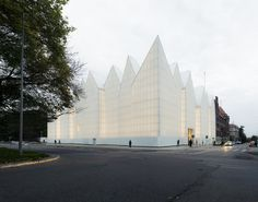 "The new Philharmonic Hall of Szczecin is located (arises) on the historical site of the ""Konzerthaus"", which was destroyed during Second World War and recomposes an urban corner in a neighborhood near to the historic city. The building houses a sy"