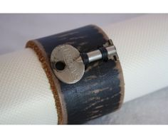 Women's black leather cuff with vintage key