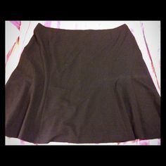 Black avenue skirt Black mid-Length skirt made by the avenue, size 30. Made of 72% polyester, 23% rayon, & 5% spandex. It does have a side zipper and hits me about 6 inches below the knee (I'm 5'9). Beautiful flow to the skirt, only worn a couple of times. Pet and smoke free home. Avenue Skirts A-Line or Full
