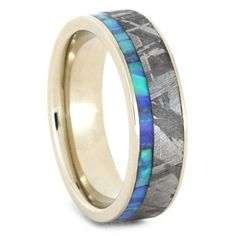 Opal jewelry has never looked so good! This white gold womens wedding band is inlaid with my signature Gibeon Meteorite inlay. The gorgeous materials lay...