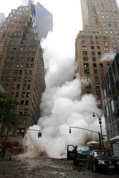 As one of the tower collapses, sending a lethel cloud filled with debris & whatever into the street to wreck more havoc.