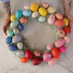 It doesn't feel like spring without a plastic Easter egg craft, and this handmade wreath is sure to welcome the season. You can make your own DIY Easter wreath with materials found at the dollar store. With just a little decoupage and some hot glue, you can create this super easy DIY wreath for your front door! #easterwreathforfrontdoor #easterwreath #diywreath #bhg