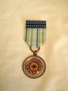 Steampunk Military Medal -Gears. $9.00, via Etsy.