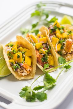 These fresh and flavorful fish tacos are made with broiled tilapia and topped with a sweet and spicy fresh mango salsa.